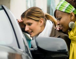 Girls looking into a vehicle they want to finance