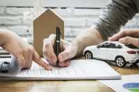Auto insurance policy signature. Home owners insurance paperwork.